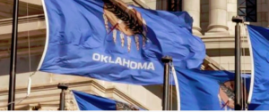 Oklahoma flags blowing in wind on state capitol