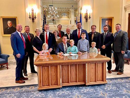 Gov. Stitt, Don Spencer and Legislators at signing of Second Amendment Sanctuary Bill